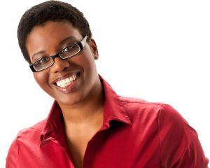 c55-06-Studio-headshot-on-white-background-of-smiling-black-woman-with-short-afro-and-red-shirt(Shamara-Loraine)